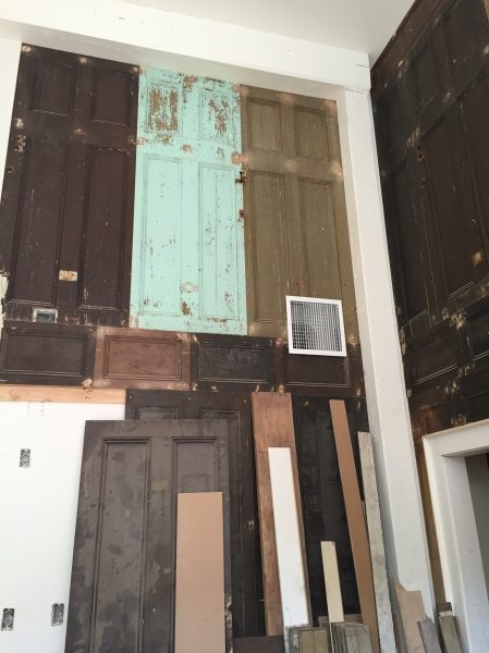 A lot of the wood used in the hotel has been salvaged from other parts of the building, including the old doors that line the walls of the lobby.